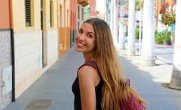 Smiling beautiful tanned woman walking in Puerto de la Cruz, Tenerife royalty free stock images