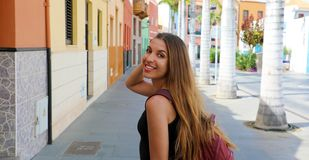 Smiling beautiful tanned woman walking in Puerto de la Cruz, Tenerife stock photo