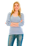 Smiling beautiful teen girl with crossed arms Royalty Free Stock Photography