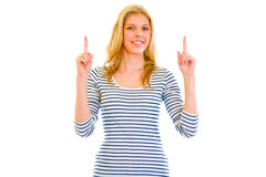 Smiling beautiful teen girl pointing finger up Royalty Free Stock Photo
