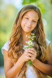 Smiling beautiful teenage with bouquet of daisies Royalty Free Stock Photos