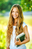 Smiling beautiful teenage girl with books Stock Photos