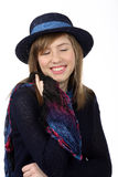 Smiling beautiful teenage girl with navy hat and closed eys Royalty Free Stock Photos