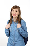 Smiling beautiful teenage girl with a school backpack Royalty Free Stock Images