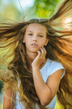 Smiling beautiful teenage wind with flying hair Stock Photos