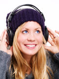 Smiling beautiful teenager with headpho Stock Images