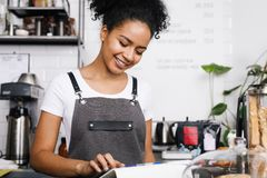 Smiling beautiful waitress using digital tablet Stock Photo