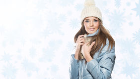 Smiling beautiful woman with beige cap and scarf.  stock photography