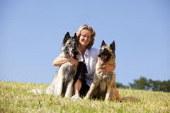 Smiling beautiful woman with Belgian shepherds Stock Images