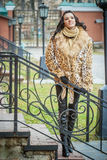 Smiling beautiful woman in a brown coat Royalty Free Stock Photos