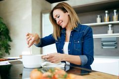 Smiling Beautiful Woman Cooking Vegetable Soup In The Kitchen At Home Royalty Free Stock Photos