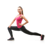 Smiling beautiful woman doing exercise Royalty Free Stock Photo