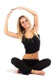Smiling beautiful woman doing exercise Stock Photos