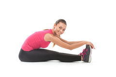 Smiling beautiful woman doing exercise Stock Images