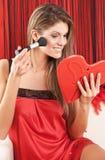 Smiling beautiful woman doing makeup Royalty Free Stock Photos