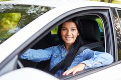 Smiling woman driving her car stock photography