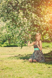 Smiling beautiful woman and flowering tree Royalty Free Stock Image