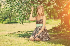 Smiling beautiful woman and flowering tree Stock Photos