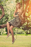 Smiling beautiful woman with flowering tree Stock Images