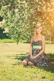 Smiling beautiful woman and flowering tree Royalty Free Stock Photo
