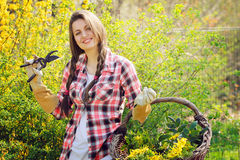 Smiling beautiful woman in a garden full of flowers Royalty Free Stock Images