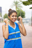 Smiling beautiful woman with headphones before exercise. Stock Images
