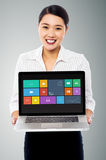 Smiling beautiful woman holding laptop Royalty Free Stock Photography