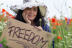 Smiling beautiful woman holding a paper banner with text Royalty Free Stock Photos
