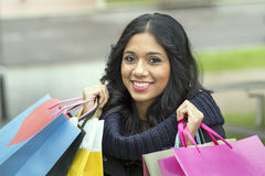 Smiling beautiful woman holding shopping bags. Stock Photo