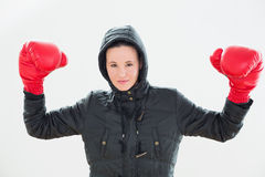Smiling beautiful woman in hood and red boxing gloves Royalty Free Stock Images