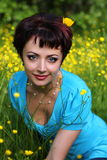 Smiling beautiful woman laying on grass Royalty Free Stock Photos