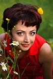 Smiling beautiful woman laying on grass Royalty Free Stock Images
