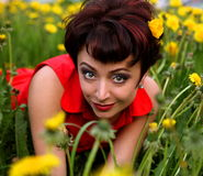 Smiling beautiful woman laying on grass Stock Images