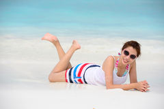 Smiling beautiful woman lie on the beach lie on the beach Stock Photo