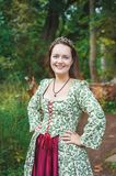 Smiling beautiful woman in long medieval dress royalty free stock photo