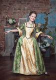Smiling beautiful woman in medieval dress dance Stock Photography