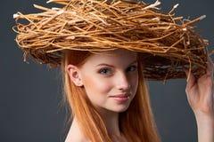 Smiling beautiful woman in natural wreath Stock Photos