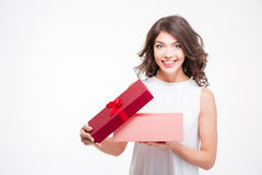 Smiling beautiful woman opening gift box Stock Photography