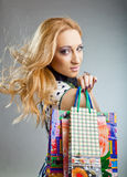 Smiling beautiful woman with paper shopping bags Stock Photography
