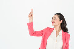 Smiling beautiful woman pointing up with her finger Royalty Free Stock Photo