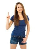 Smiling beautiful woman pointing up Royalty Free Stock Image