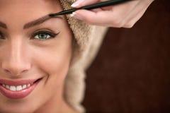 Smiling beautiful woman on professional make up treatment Royalty Free Stock Photo