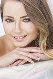 Smiling Beautiful Woman Resting on Hands Royalty Free Stock Photography