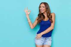 Smiling Beautiful Woman Showing Ok Hand Sign Stock Images