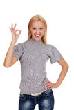 Smiling beautiful woman showing okay gesture stock photography
