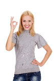 Smiling beautiful woman showing okay gesture Royalty Free Stock Image