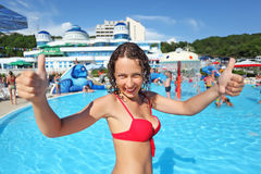 Smiling beautiful woman standing in pool Royalty Free Stock Images