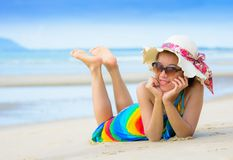 Smiling beautiful woman sunbathing on a beach Royalty Free Stock Image