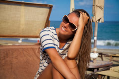 Smiling beautiful woman sunbathing on a beach Stock Images