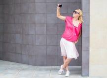 Smiling beautiful woman taking selfie Royalty Free Stock Images